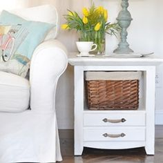 side table makeover. The basket is great. Hide the clutter that all homes have.