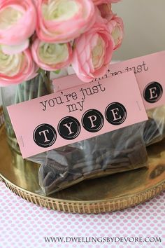 Free Valentine's Day Printable Bag Toppers.  Fill the bags with alphabet cookies for a fun treat!