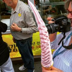 This is how you soft serve. More than a foot of strawberry/vanilla swirl seen in Myeong-Dong Seoul South Korea.