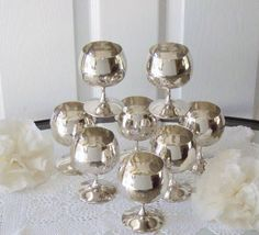8 Silver plate goblets, stemmed glasses, toasting glasses, wine/brandy glasses, made in Spain. Each holds 6 ounces and are 4 1/4 tall. Great