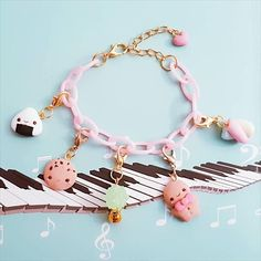 ❤This Cute Kawaii Pink Lollita Charm Polymer Clay Bracelet with Gingerbread and Chocolate Cookie may vary from the photo as it will have to be handmade. ❤Do you like this Bracelet, but you want another charm? Please contact me for custom order. ❤All my charms are made with polymer