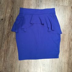Bebe Peplum Skirt Cute and flattering cut. Comfortable. Great vibrant color. bebe Skirts