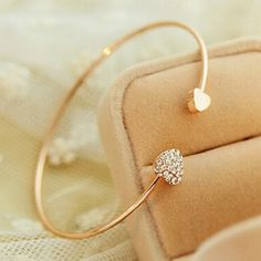 Heart shaped danity gold love cuff bracelet Brand new with tags✨material: alloy,crystals✨ color: gold✨ expect fast shipping 💕 Any questions please ask 🤗please check out my other listings✨ 15% off on bundles 🤑buy more 🛍 save more 💸 Jewelry Bracelets