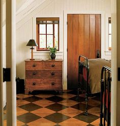 Stunning black stained harlequin over traditional exposed stained background.  Really like the painted wood floor.