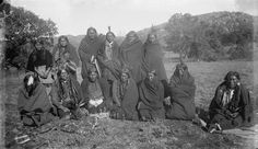 Quanah Parker (seated second from left) with a Comanche group the morning after an all-night prayer ceremony – 1892 {Note: The Lipan Apache/Tonkawa man known as Chevato, who was adopted by the Comanche and changed his name to Chebahtah, sits on the far right.}