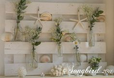 MISC:  Seashells    http://www.songbirdblog.com/2011/09/pallet-wood-summer-mantel-beach-theme/#