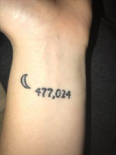 A matching tattoo with my mom instead of saying I love you to the moon and back we got the miles