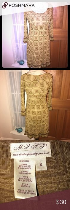 M.S.S.P. Flattering Dress Size S This dress is beautiful on, it's actually a golden yellow with brown design. Long sleeves with tiny ruffle at the cuffs and also at the hem. Comes just below the knee. Size Small - in excellent condition Max Studio Specialty Products Dresses
