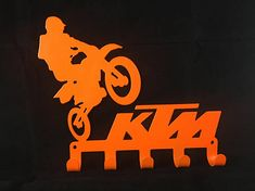 KTM MOTORCROSS Key / Coat / Towel Rack CNC Plasma cut & powder coated with choice of colours and styles Mounts easily with two holes and have 5 hooks so you never loose your keys again. Dimensions: 242mm wide by 204mm tall Professionally finished in high quality Powder Coating. Please