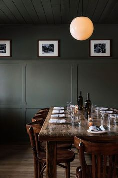Another example at the Anvil Hotel in Wyoming, paneling applied two-thirds the way up the wall also creates a greater sense of height. (See Go West: A Mountain Lodge in Jackson, WY, by a Brooklyn Design Studio. Dark Green Walls, Dark Walls, White Walls, Dark Painted Walls, Gray Green, Dining Area, Kitchen Dining, Dining Rooms, Kitchen Decor