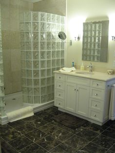 Glass block curved shower, custom vanitities and medicine cabinets