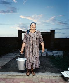 Six years after the last war, Eset Umarov is still repairing her house in Chechnya. (Rob Hornstra)