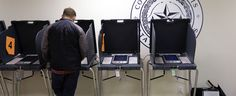 In this Wednesday, Feb. 26, 2014 photo, a voter casts his ballot at an early voting polling site, in Austin, Texas.