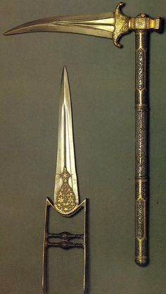 Indian weapons. Katar (push dagger), 17th century. Steel, damascened and inlaid with gold.  Zaghnal (war hammer / pick) 18th century. Steel, damascened and inlaid with gold.  The Museum of Oriental Art, Moscow.