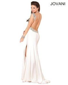 Jovani 1581 Off White Evening Gown Prom Formal Dress 0 4 6 - Price: $500.00: Take a walk on the glitzy side with this traffic-stopping Jovani 1581 creation! Brightly twinkling rhinestones liven up the style of the bodice, which has a curved neckline, and run up each of the broad shoulder straps. Ruched material runs down from the empire waist before segueing into a sleek, floor-length skirt with an up-to-there side slit.
