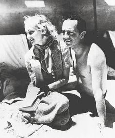 Carole Lombard and William Powell at the Hawaiian beach.