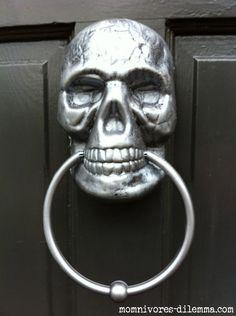 DIY skull door knocker Cover door knocker with spray-painted skull and cheap bathroom towel holder -