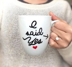 Short and sweet, this mug really gets to the point. There is no better way to show off your new shiny diamond than an arrow pointing directly to it. ($22) @myweddingdotcom