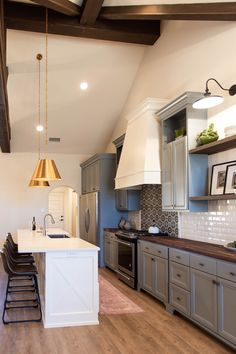 Trendy Kitchen design, vaulted ceilings, subway tile, cement tile backsplash, open shelving | By Ventura Homes in Lubbock, Texas