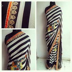 Printed sari with woven borders. Perfect cocktail sari.