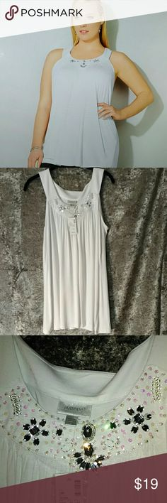 NWT Avenue Embellished Tank Top 14/16 NWT Beautiful embellished sleeveless tank top. Large faceted stone medallions with acrylic bead accents at the yoke. Scooped neckline. Extra embellishments come with it. Approximately 32 in long and 28 in across the bust, though it is a softly draped, stretchy fabric. I always entertain offers and love to bundle to give you even deeper discounts. Just let me know what you think. Happy Shopping! Avenue Tops Tank Tops