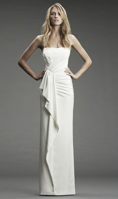 Perfectly straight dresses are usually found in a minimalist's attire, but this dress has the added feature of interesting pleating which gives it a fresh new look and makes it more of a modernist's taste. It is designed by Nicole Miller and its style number is FA0027. It is available through the Bridal Dream Dress website.