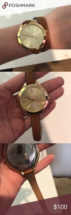 Michael Kors Authentic Wrap Watch Basically brand new watch. I was given this as a gift, is not really my style. Maybe worn it 2-3 times, has just been sitting in my watch box. Great condition, no scratches. Comes with box. Michael Kors Accessories Watches