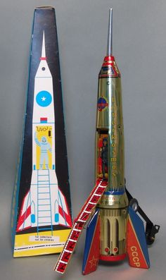 """This tin rocket was made in Hungary - during the era when the USSR was still in existence. About 15.5"""" high, when it moves forward and strikes an obstacle, the craft raises itself and a ladder extends"""