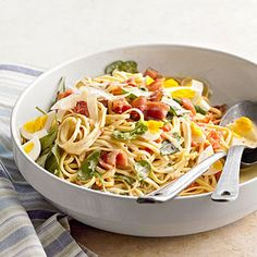 Bacon and Egg Pasta If you're tired of spaghetti cooked the traditional way, try this skillet version recipe that combines an egg mixture with bacon, baby spinach, pasta, and topped with shredded Asiago cheese.