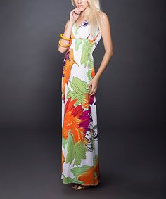 Sweep the day off its feet in this magical maxi. A sleek, swish-able style slims the look, while a flexible silhouette and tasteful tropical print make for a breezy feel. Measurements (size S): 55'' long from high point of shoulder to hem