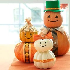 An adorable pumpkin family is a great centerpiece for your Halloween table. You can use real pumpkins or pick up some craft pumpkins at your favorite hobby store.