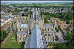 https://flic.kr/p/22EsTwX | Ely, Cambridgeshire | Ely Cathedral, viewed from the west tower.  The city of Ely sits north of Cambridge in the east anglian fens, it is dominated by its medieval cathedral, sometimes called 'The ship of the fens'.  Ely Cathedral is located in the centre of the historic city and is surrounded by medieval monastic buildings, parkland and meadows.