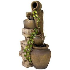 Experience the soothing sound of water transferring from one spouted jug to the next with this lovely fountain.