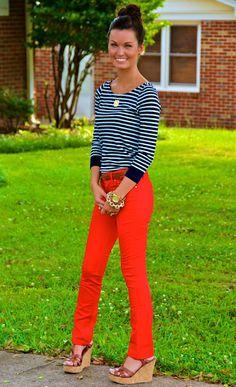 Nautical stripe shirt, red skinnies, brown sandal wedges, and a brown skinny belt.