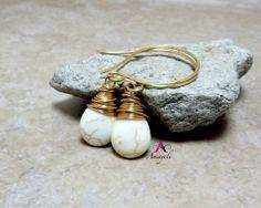 White turquoise teardrop wire wrapped dangle earrings by Amayeli, $18.00