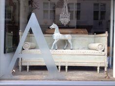 Latest shop window Gustavian bench and Decorative Swedish horse