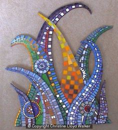 Lovely change of pace from round/square/boring. Mosaic Wall, Mosaic Glass, Mosaic Tiles, Stained Glass, Glass Art, Mosaic Mirrors, Sea Glass, Mosaic Crafts, Mosaic Projects