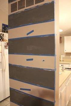 Striped accent wall -- for the boys' room -- and maybe one stripe is chalkboard paint?