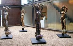 Bronze and aluminum Sculptures of females by artist Carole Feuerman titled: 'Four Goddesses (Earth, Water, Air , Fire)'