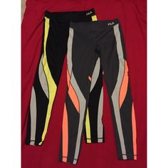 FILA reflective workout leggings Grey ones no longer available. Black pair is on sale. Bright yellow and black. Reflective athletic leggings. Mint condition. Open to offers. Fila Pants Leggings