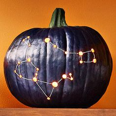Stargazing - Paint a hollowed out pumpkin in dark blue or black, let dry. Print a constellation pattern and trace the pattern onto the pumpkin. Use different-sized drill bits to make holes in the flesh, then thread glow-in-the-dark string through the holes. Illuminate with a candle.