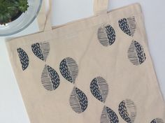 A personal favourite from my Etsy shop https://www.etsy.com/uk/listing/453739214/leaf-pattern-canvas-tote-bag-linoprint