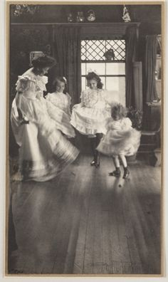 'The Dance', depicting a woman and three children dancing in a domestic interior, taken by Gertrude Käsebier in about 1905