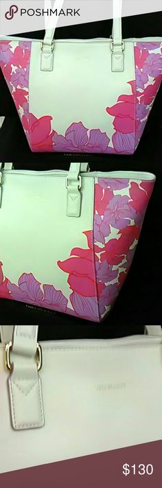 Vera Bradley genuine leather white floral tote This is a small Ella tote in genuine leather.  It is white with large flowers in pink and purple and gold hardware.  The bag zips closed, with a lovely pink floral lining, two slip pockets and one zip pocket.  Best of all, a hidden slip pocket in the top seam, perfect for cell, that can be accessed even when the bag is zipped.  This is amazing!  Will get you compliments for sure!!  Just unwrapped for photos, will be stored in dustbag on the…