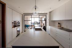 modern kitchen. kitchen island. white and grey kitchen. kitchen ideas. hexagon tiles