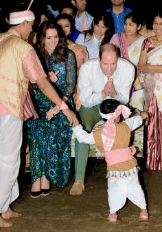 thecambridgees: The Duke and Duchess of Cambridge watch dancing by the fireside during a Bihu Festival Celebrationat Diphlu River Lodge on day 3 of the royal visit to India and Bhutan on April 12, 2016 in Kaziranga, India.