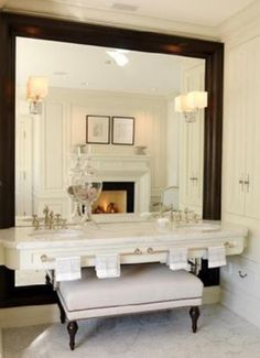 Julie Charbonneau's bathroom in her Montreal home.  The huge mirror behind the vanity.  Brilliant!