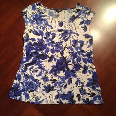 Flower print sleeveless top DAISY FUENTES black/blue/white Floral print sleeveless top with asymmetrical neck line. Nice soft material. No stains or rips. Daisy Fuentes Tops Tank Tops
