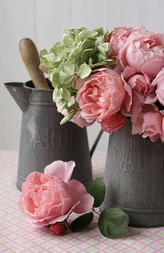 So pretty! Pink cabbage roses in galvanized pitchers #flowers #floral