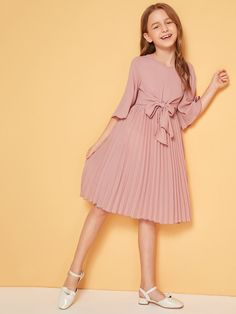 To find out about the Girls Bell Sleeve Tie Front Pleated Dress at SHEIN, part of our latest Girls Dresses ready to shop online today! Girls Dresses Online, Kids Outfits Girls, Little Girl Dresses, Girl Outfits, Toddler Girl Dresses, Girls Fashion Clothes, Kids Fashion, Fashion Dresses, Box Pleated Dress
